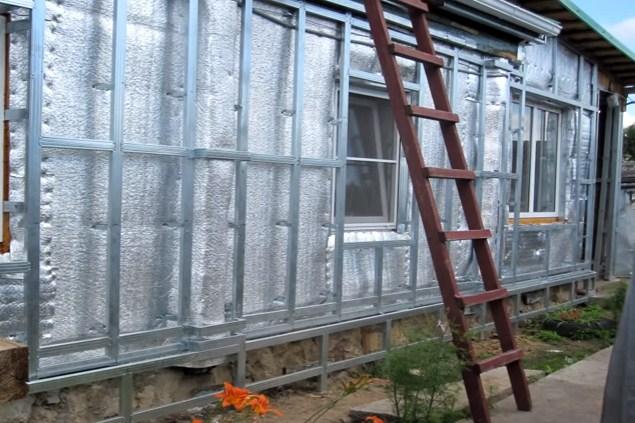 Обшивка деревянного дома профнастилом своими руками с утеплителем 73